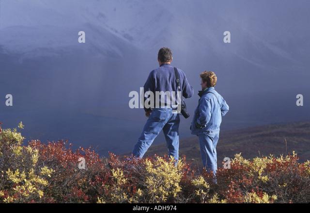 Hikers View Alaska Range From Polychrome Pass DNP AK - Stock Image