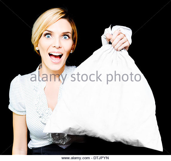 Elated vivacious retail sales woman giving her endorsement holds up a blank white bag suitable for your conceptual - Stock Image
