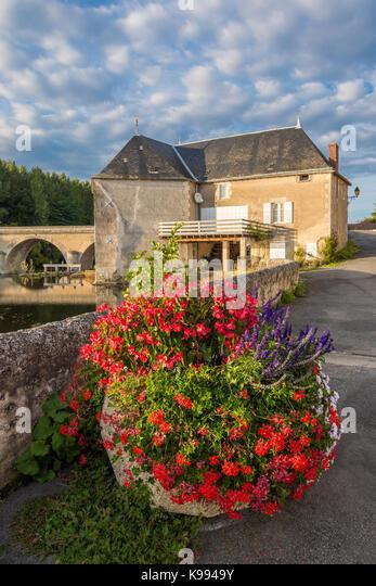 Mill and bridge over river Gartempe, Saint Pierre de Maillé, France. - Stock Image