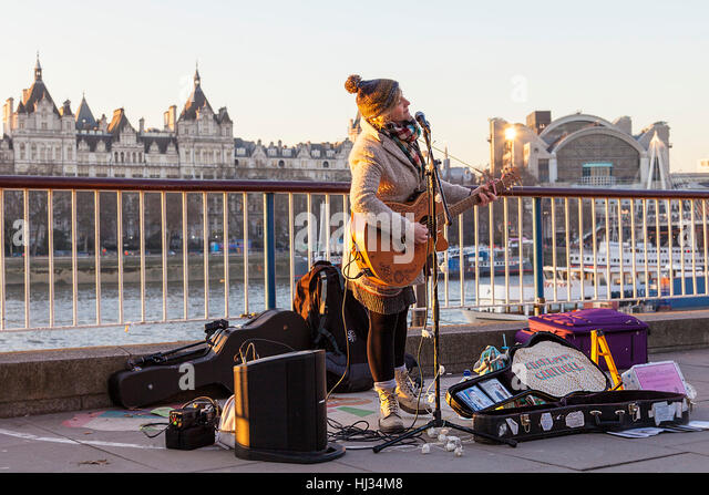 Popular singer,  Charlotte Campbell, in her usual spot at South Bank, Inner London - Stock Image