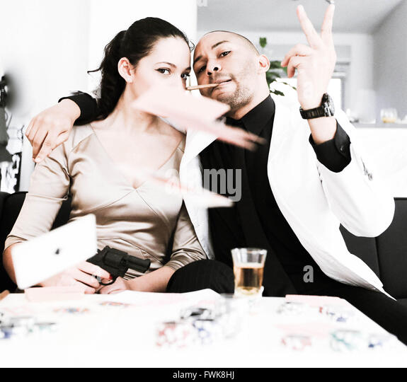 Portrait Of Fashionable Gangster Friends Throwing Cards At Home - Stock-Bilder