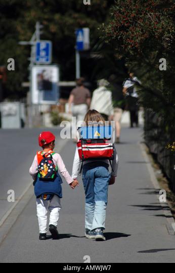 Switzerland children walking home from school - Stock Image