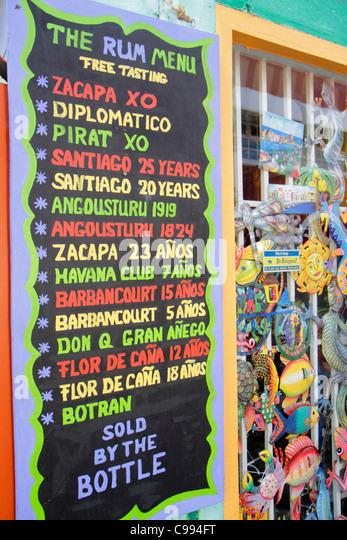 Curaçao Netherlands Antilles Dutch Willemstad Punda Columbusstraat gift shop souvenir rum menu Don Q Flor de - Stock Image