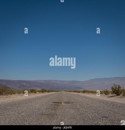 Wide Shot of Desert Road Through Mountains in Utah - Stock Image