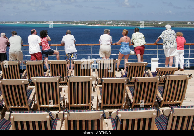Grand Turk Turks Island Passage Cockburn Town Holland America Line ms Noordam passengers rail chairs - Stock Image