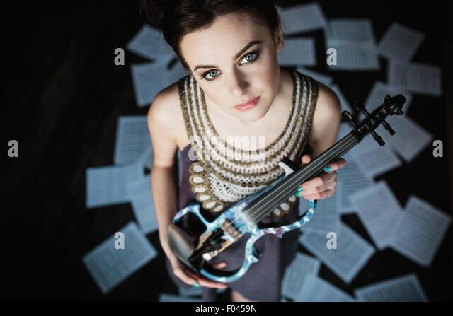 girl posing and holding a violin - Stock-Bilder