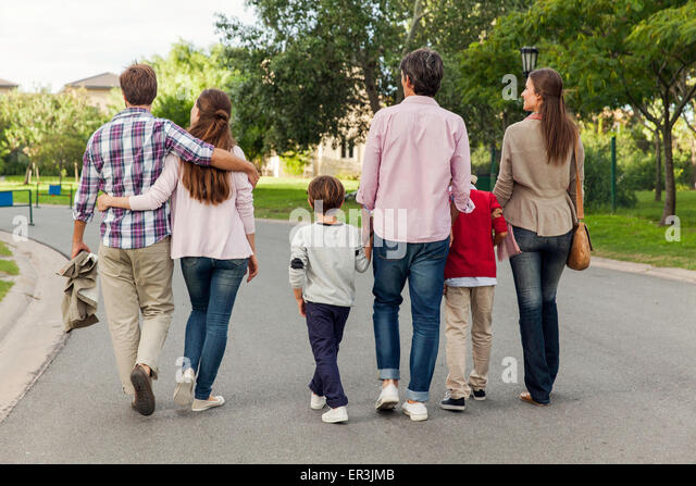 Family walking together in street, rear view - Stock-Bilder