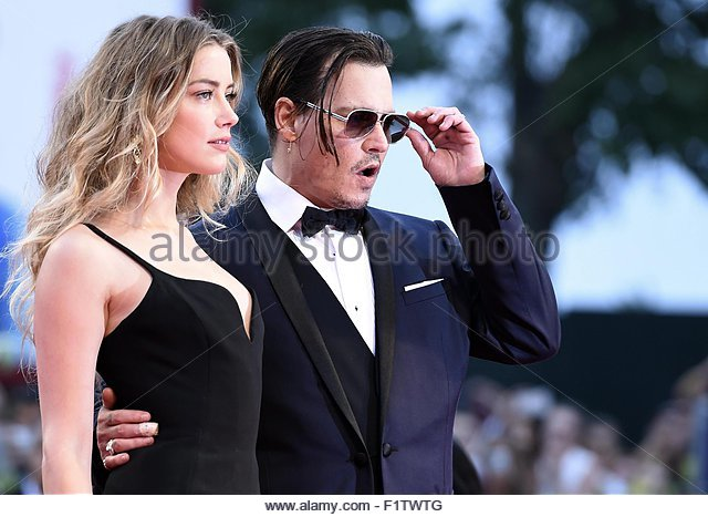 epa04913279 US actor/cast member Johnny Depp (R) and his wife US actress Amber Heard, arrive for the premiere of - Stock Image