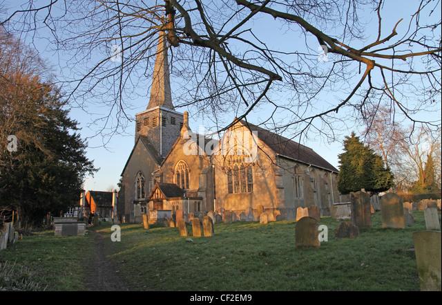 St Bartholomew's Church, Horley, Surrey, bathed in winter sunlight. - Stock Image