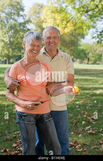 Senior couple playing badminton - Stock Image