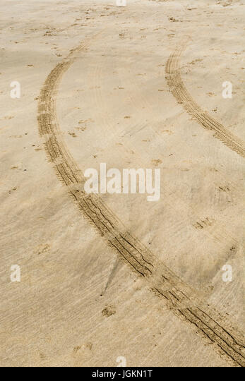 Tyre tracks / tire marks on Fistral beach. - Stock Image