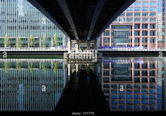Reflection from buildings, part of the Canary Wharf development in West India Millwall Docks on the Isle of Dogs - Stock-Bilder
