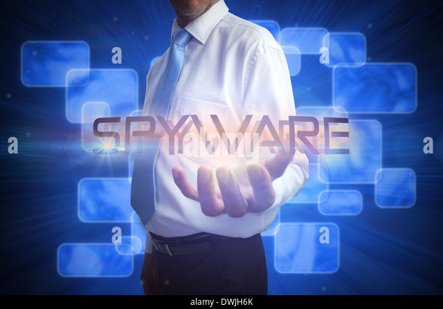 Businessman presenting the word spyware - Stock Image
