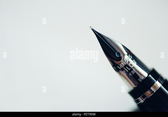 Close-Up Of Fountain Pen Against White Background - Stock Image