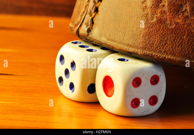 Two dices in a gammon boad - Stock Image