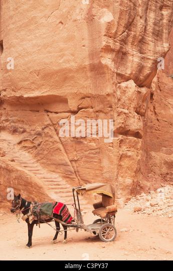 Jordan, Petra, View of donkey cart at temple - Stock Image
