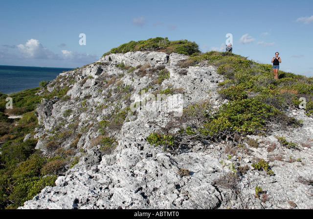 Grand Turk Atlantic Ocean Hawknest Plantation Gun Hill dune buggy excursion tour rocky trail hikers - Stock Image