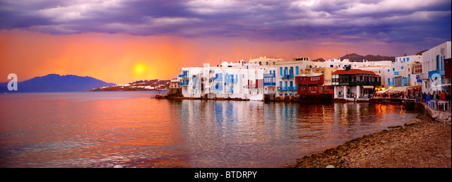 Sunset over The Little Venice (Venetia) neibourhood of the Kastro District of Chora, Mykonos, Cyclades Islands, - Stock Image
