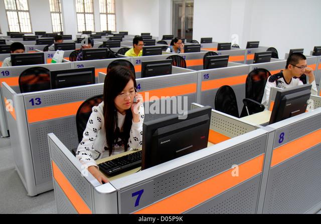 Shanghai China Yangpu District Tongji University Siping Campus student library Asian man woman teen boy girl computer - Stock Image