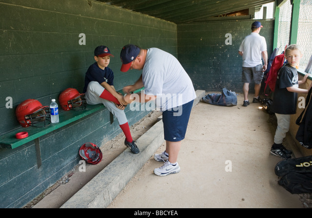 In the dugout at Little League baseball game LeRoy New York Genesee County - Stock Image