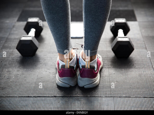 Closeup image of a female legs at gym - Stock-Bilder