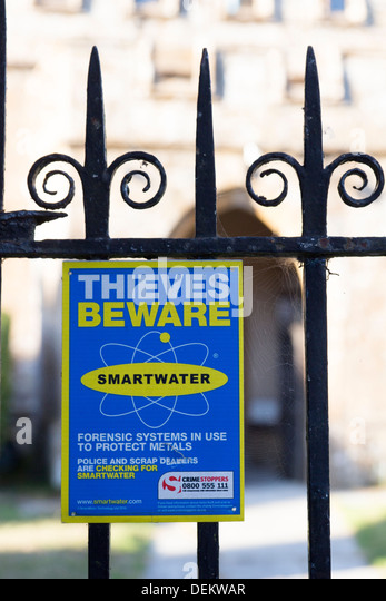 A sign warning potential thieves. Blessed Virgin Mary Church, a fifteenth century church in the village of Donyatt - Stock Image