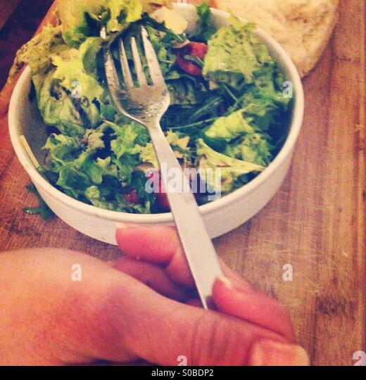 Woman eating salad - Stock Image