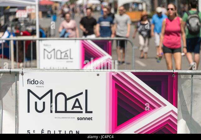 Montreal, Canada. 11 June 2017. Saint Laurent street during Mural Festival - Stock Image