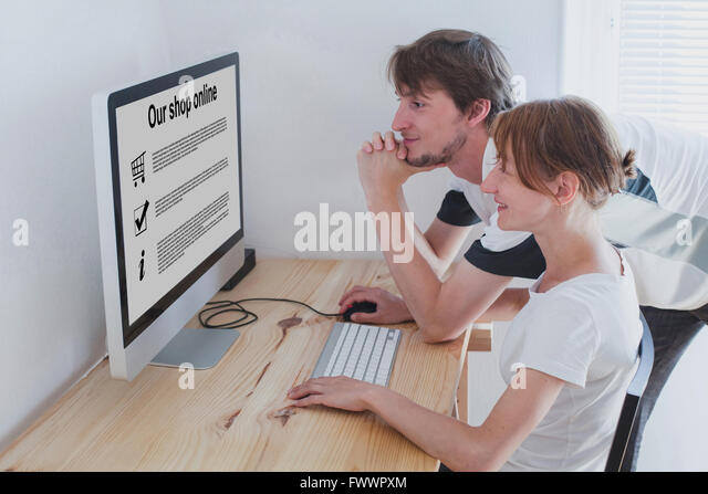 shopping online concept, family looking to the screen of computer - Stock Image