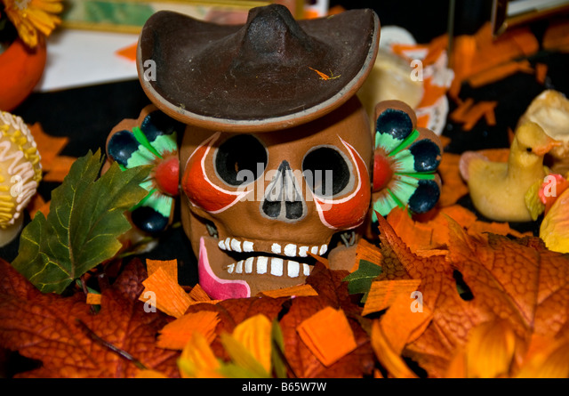 Skull smiling with black hat Day of the Dead Mexican tradition Dia de los Muertos celebration San Antonio Texas - Stock Image