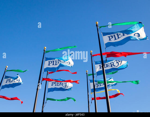 Flags denoting Pier 39 on Fisherman's Wharf in San Francisco, California.  Pier 39 is a popular tourist attraction. - Stock Image