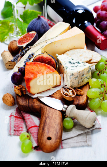 Wine and cheese plate - close up image - Stock Image