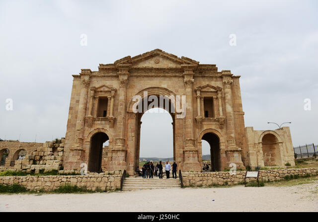 Hadrian's arch in the ancient Roman city of Jerash in Jordan. - Stock Image