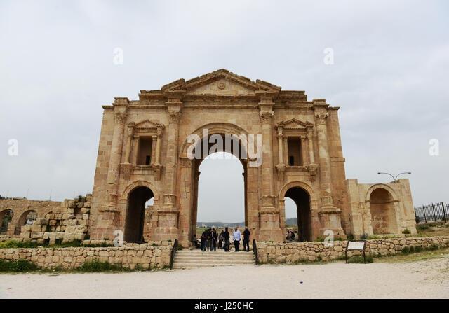 Hadrian's arch in the ancient Roman city of Jerash in Jordan. - Stock Image