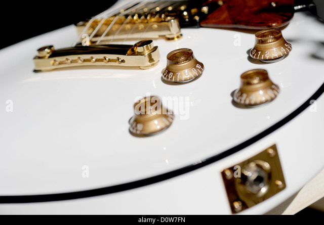 Close up of white Gibson Les Paul guitar - Stock Image