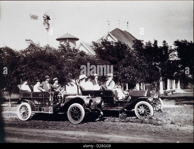 Group of People in Two Touring Cars, Circa 1908 - Stock Image