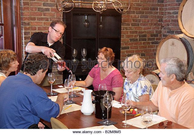 Michigan Traverse City Old Mission Peninsula Brys Estate vineyard winery wine cellar buffet group tour tasting evaluate - Stock Image