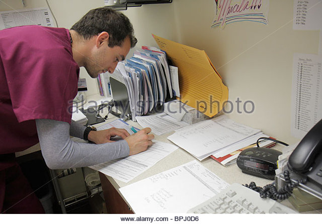 Miami Beach Florida Mt. Mount Sinai Medical Center hospital doctor's office EKG technician medical records career - Stock Image