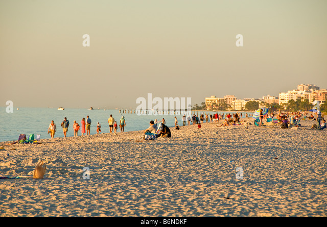 Naples Municipal Beach Naples Florida fl late afternoon sunbathers soft light white sand - Stock Image