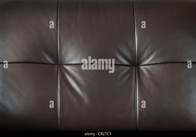 Closeup of luxurious expensive brown leather furniture, background - Stock Image