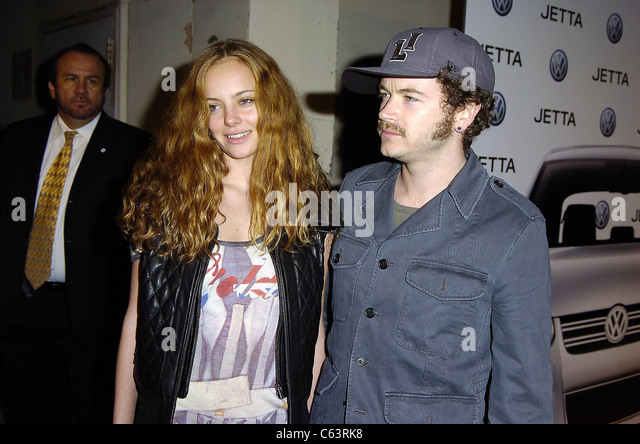 Actress Bijou Phillips and actor Danny Masterson pose for photographers, at the launch of the 2005 Volkswagen Jetta - Stock Image