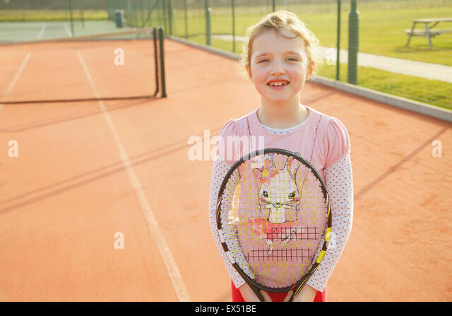 Young Girl Holding Tennis Racket - Stock Image