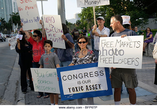 Miami Florida Biscayne Boulevard TEA tax party protest anti- government Republican Party right sign protester free - Stock Image