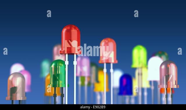 Multi-color light emitting diodes on blue background - Stock Image