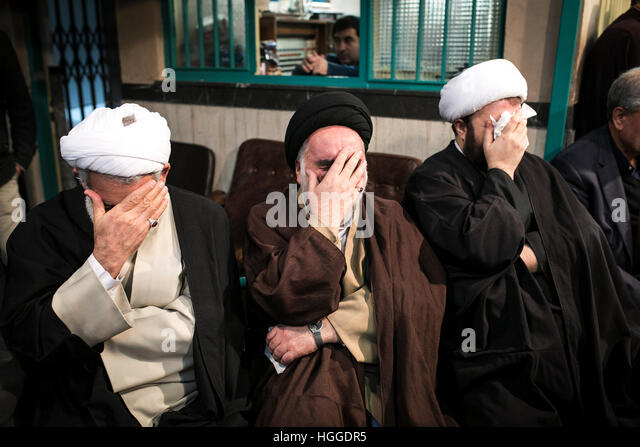 Tehran, Iran. 9th Jan, 2017. Iranian clerics cry during a mourning ceremony for Iran's influential cleric politician - Stock Image