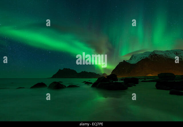 Northern Lights - Aurora Borealis shine in Sky over Uttakleiv beach, Vestvågøy, Lofoten Islands, Norway - Stock Image