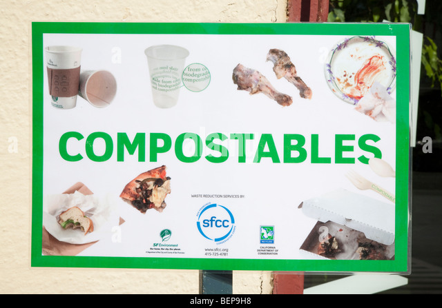 'Compostables' composting sign showing recyclable materials - food waste, paper cups, bio plastics, paper - Stock Image