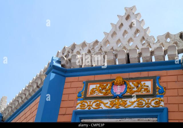 Peru Tacna Avenida San Martin building roof trim decorative detail ornamental architecture garland blue sky - Stock Image