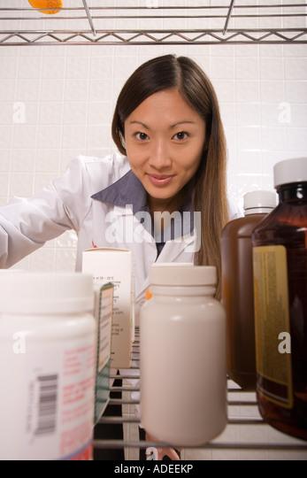 Pharmacist prepares drug order for customer pick-up. - Stock Image