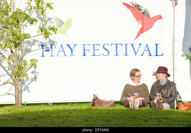 Hay-on-Wye, Powys, UK. 24th May 2015. Festival Goers relax in the evening sunshine. Credit:  Graham M. Lawrence/Alamy - Stock Image